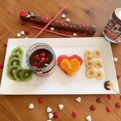 Dark Chocolate Fondue with small chocolate hearts